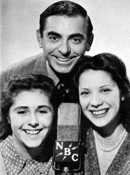 Dinah Shore's regular appearances with comedian Eddie Cantor on his weekly NBC comedy series helped to establish her popularity with audiences. Shore (far right) is pictured here with Cantor and 14-year-old classical soprano Olive Major, also a regular vocalist on the show