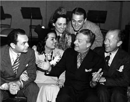 Gregarious Charles Correll entertains Edward G. Robinson, Frances Langford, Jon Hall, and his partner Freeman Gosden in this photo from 1936.