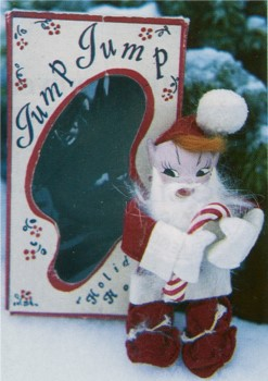 A Jump Jump doll in a Santa Claus suit.