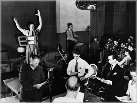 "The Mercury players, with enthusiastic direction from Orson Welles, perform ""The War of the Worlds""."