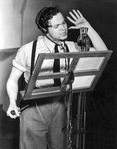 Acting, directing, and monitoring cues simultaneously, 23-year-old Orson Welles rehearses the Mercury Players in this CBS photo from 1938.